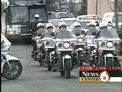 Cops on motorcycle wake